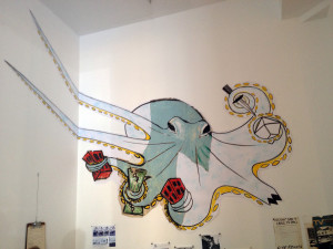 Becky Howland's octopus installed at James Fuentes Gallery; a remnant of the original in the middle of a reconstruction of the painting she pasted on the outside of the evicted building.